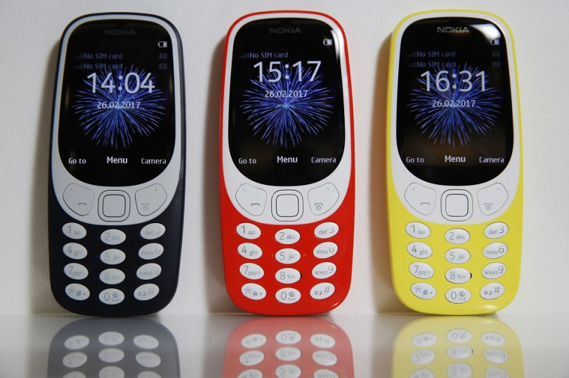 The new Nokia 3310 mobile phone, developed by HMD Global OY, in dark blue, warm red and yellow, sits on display during a product launch event in London, U.K., on Friday, Feb. 24, 2017. Licensee HMD Global says more Nokia-branded models to launch in first half of 2017. Photographer: Luke MacGregor/Bloomberg